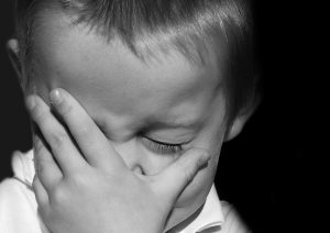 Boy frustrated with toddler sleep struggles