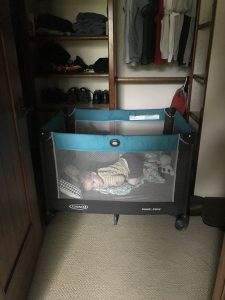Toddler asleep in a closet with traveling