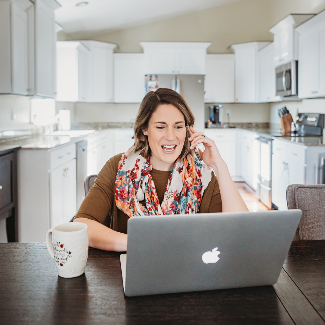Mom boss working at kitchen table